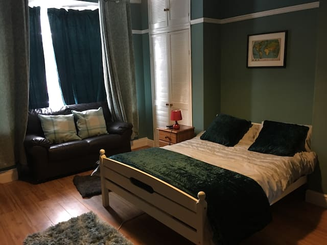 Bright large room on quiet street with garden