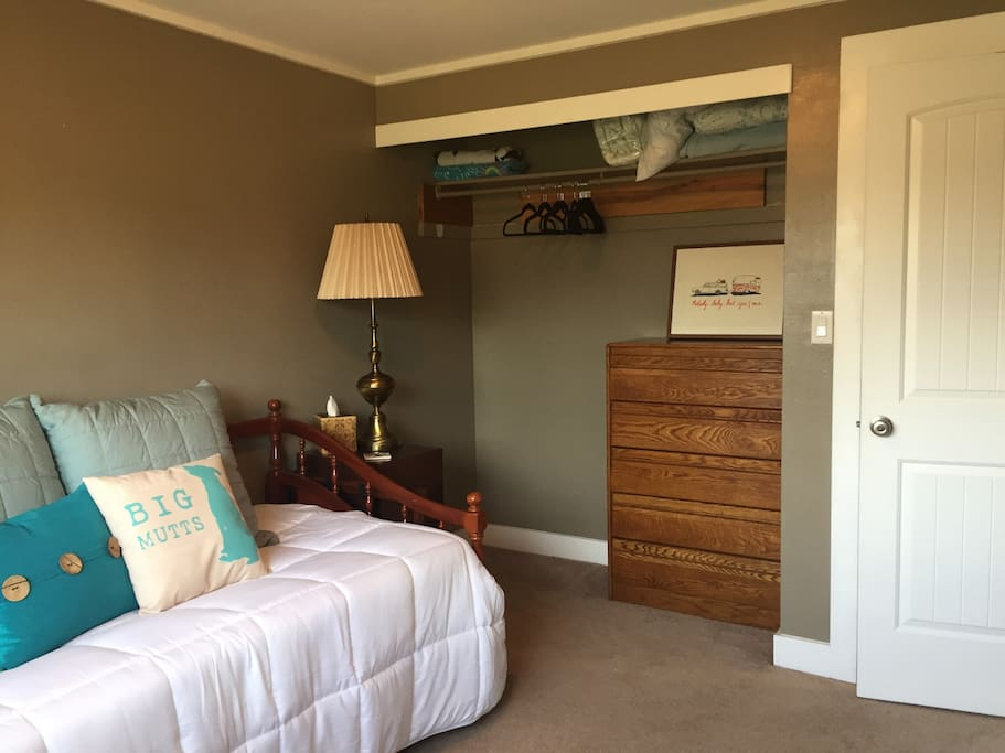 Your bedroom with closet view. Hangers and two (top) dresser drawers provided during your stay.