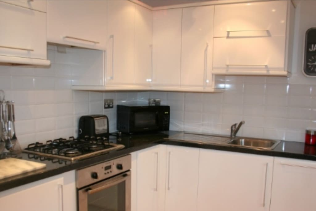 Modern kitchen with dishwasher, microwave , electric oven with gas hob, large fridge freezer and all the essentials needed