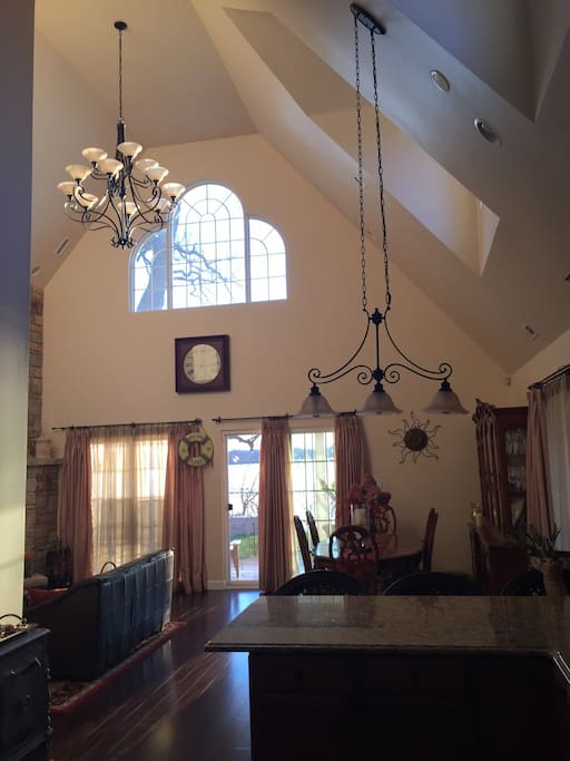 Great room and kitchen have vaulted 20' high ceilings and hardwood floors. Leather furniture.