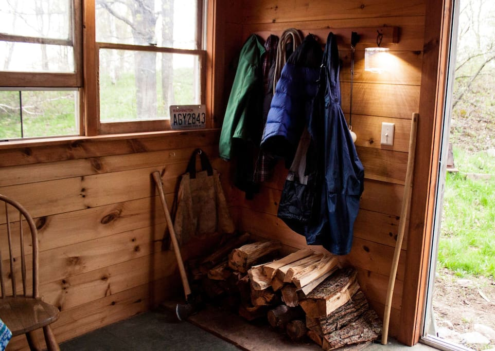 Place to hang your coats and stack wood for the stove when the nights are chilly