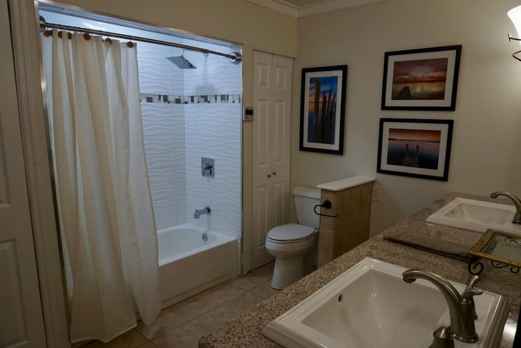 Bathroom remodeled with large sinks, new tub, modern tile and spa like shower fixtures