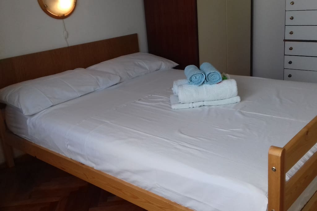 Bed equipped for summer from left side