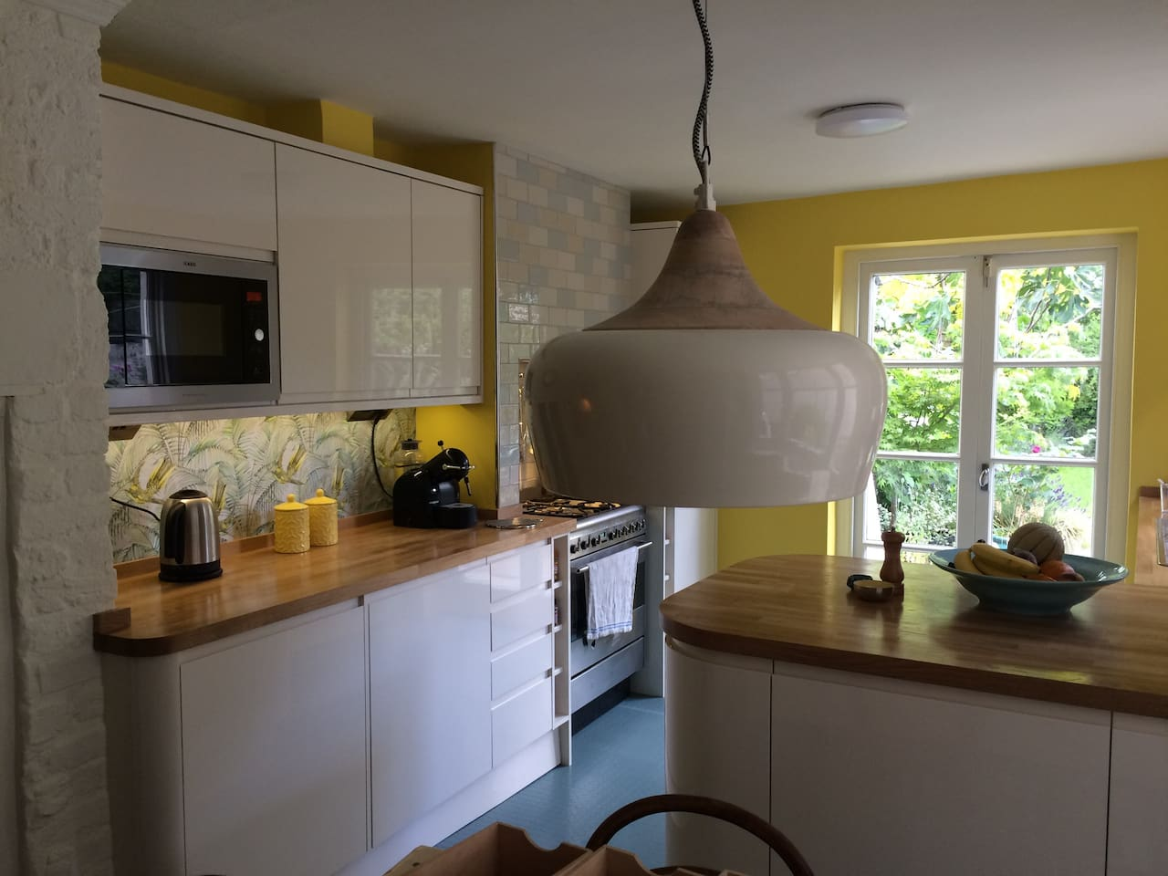 Bright, modern kitchen diner with dining table (seats 6) and French doors opening out to the gorgeous garden