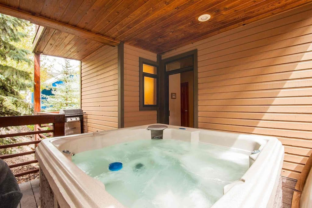 Private jacuzzi hot tub on one of 3 balconies with seating for six (6) people and BBQ grill.