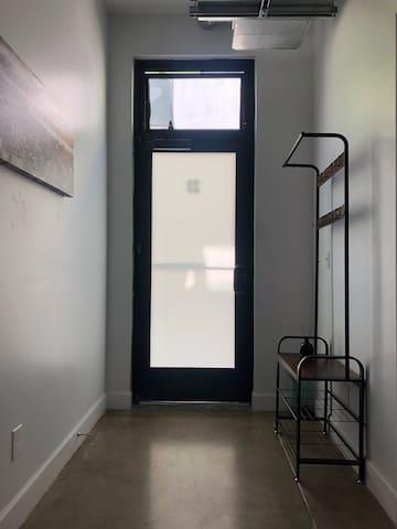 Loft entryway with original concrete floors throughout-