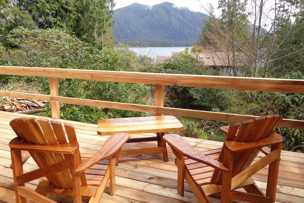 Adirondack chairs on cedar deck facing Clayoquot Sound Inlet