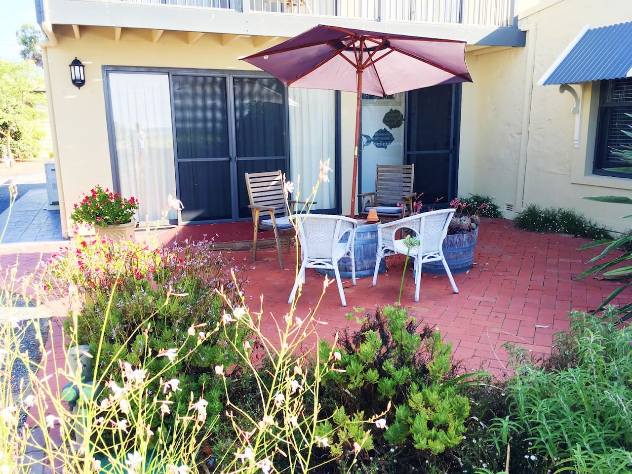 Your private courtyard overlooking Lake Albert and the cottage garden.
