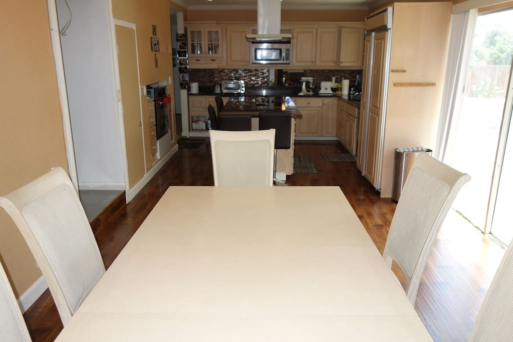 New granite kitchen with large dining table