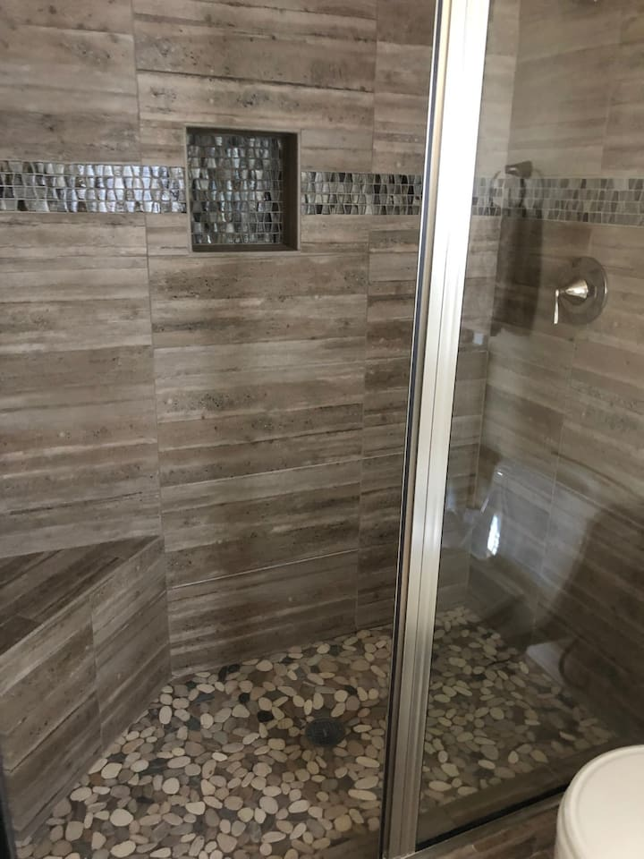 New tile and glass walk in shower.