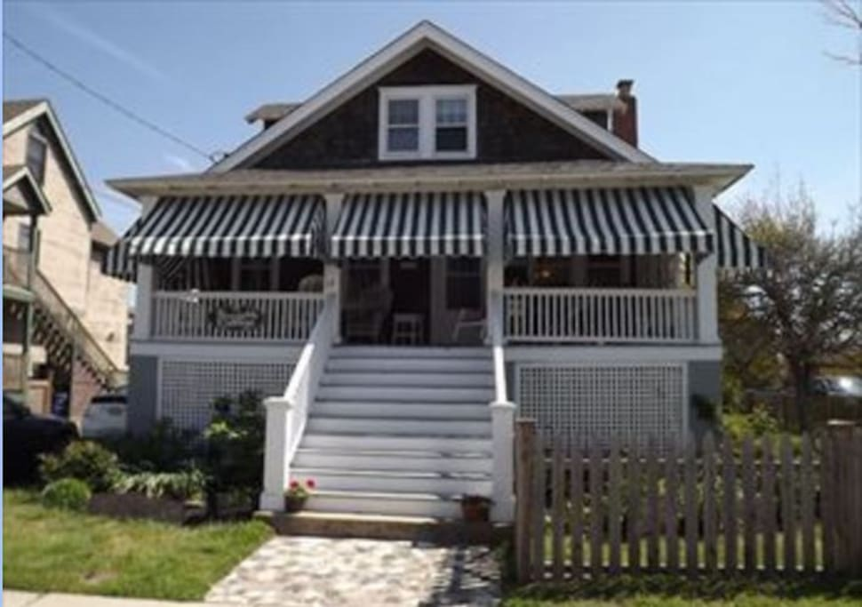 Sitting on the front porch, you will enjoy see the Cape May beach and a row of historic Victorian houses (Stockton cottages)