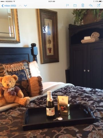 Master Suite bed tray with key, sparkling cider and chocolates to welcome you.
