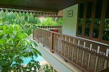 Teak walled balconies encircle three sides of the suite.