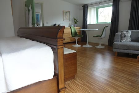 Room 1: Super King sized bed and view of dining area