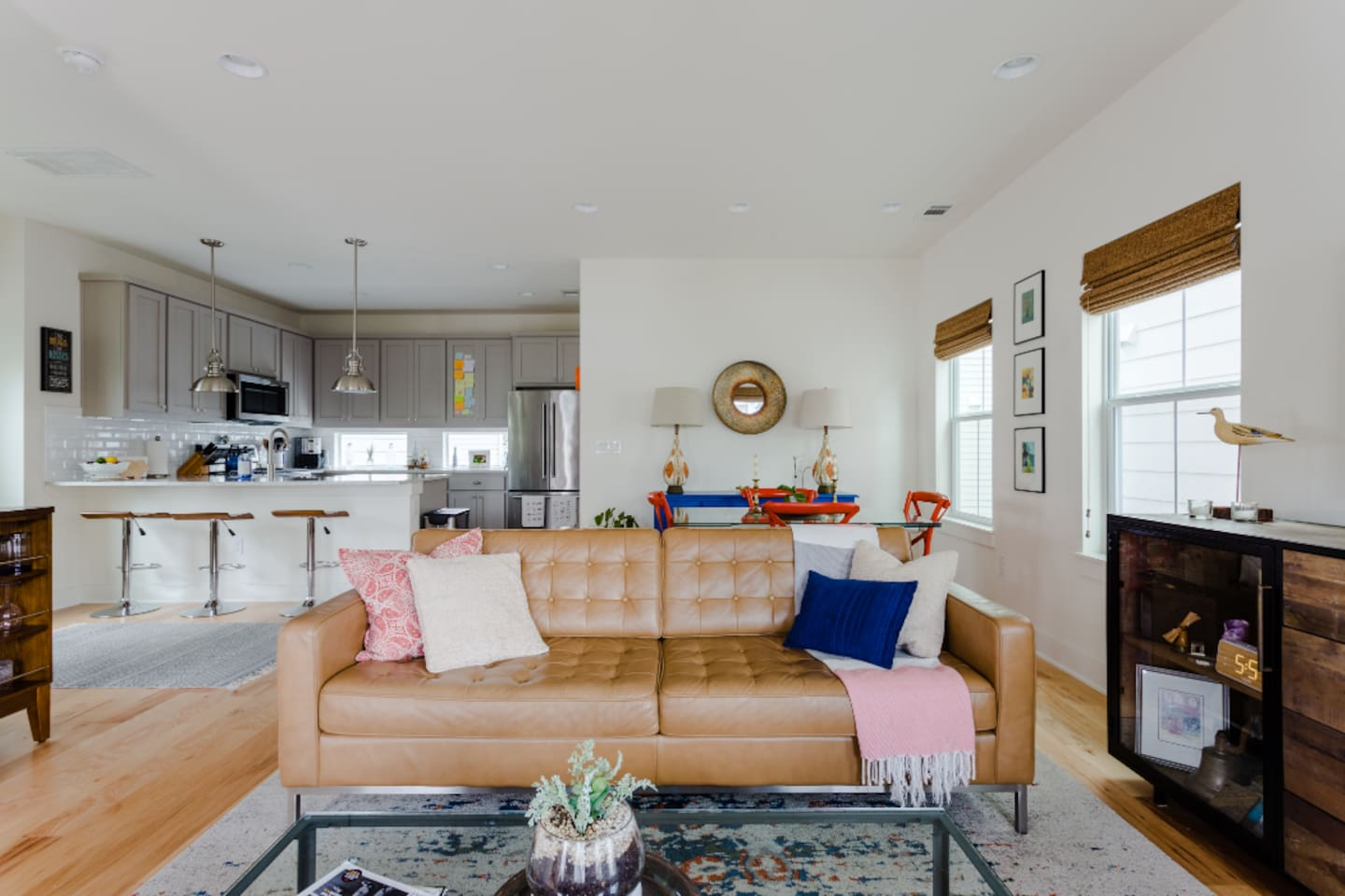 """""""The living area is my favorite part of this house because it's got a big leather couch to relax and is a nice place to hang out. It's a wide-open and everyone can gather there."""""""