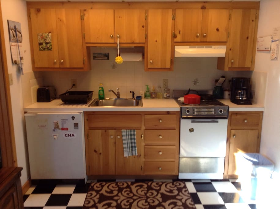 Kitchen includes stove,microwave,coffee maker,fridge,and toaster