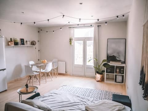 This is the shared living room with a cosy sitting area, balcony and dining table. The apartment is shared with other airbnb guests. Only the bedroom is private.