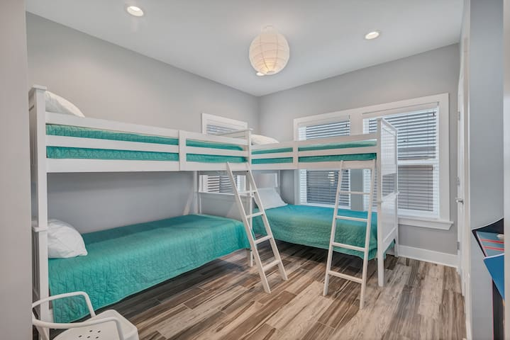 Two sets of twin over twin bunk beds just in case you don't want to leave the kiddos at home with grandma. Don't worry they also have there own private bathroom so you won't have to share.