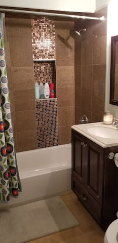 The bathroom includes a shower tub. We have great water pressure.