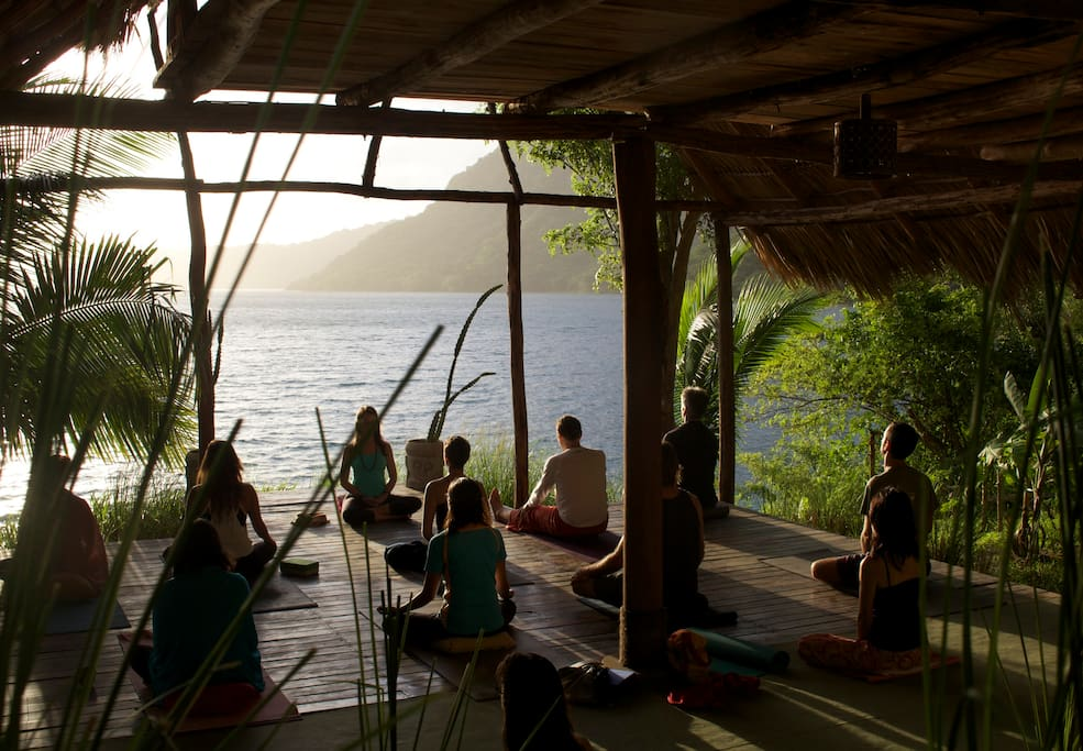 Courtesy daily morning yoga class at our palapa overlooking the water