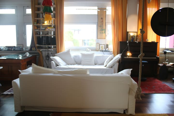 2 bed sofas in large Living-room with Dining-Area and Fireplace