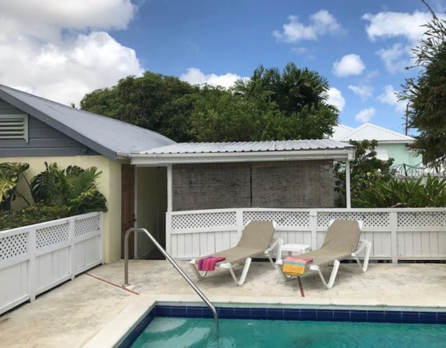 View of cottage and plunge pool with sunloungers