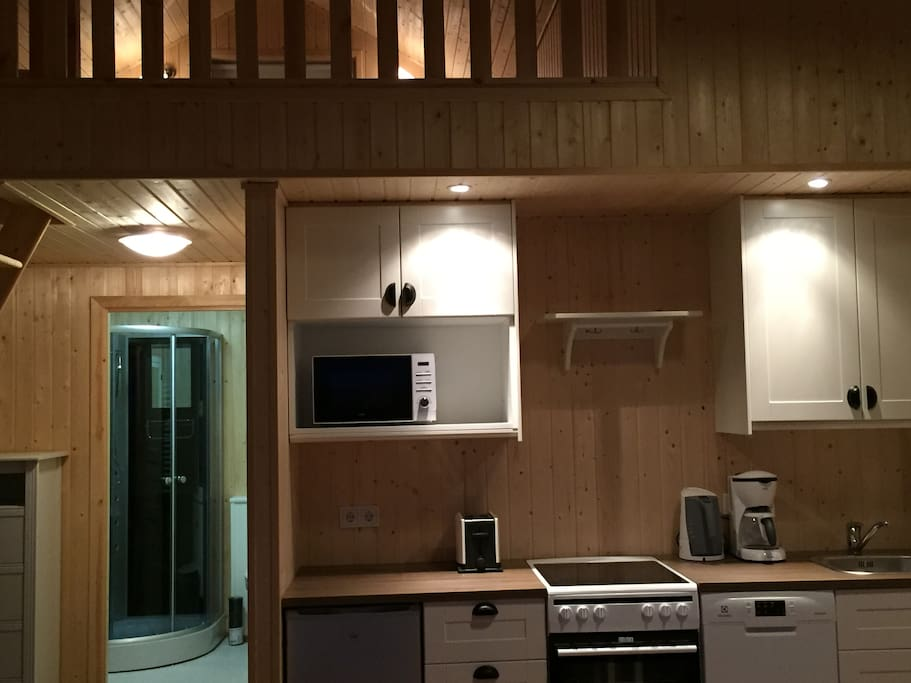 Full kitchen with stove and refrigerator