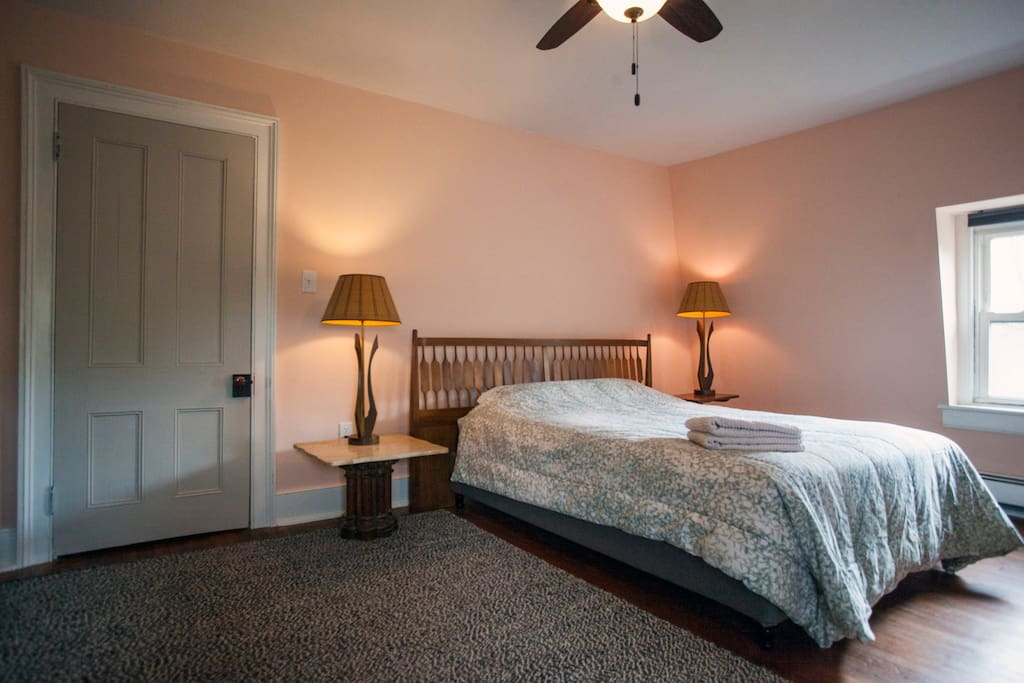 It features a queen size bed with a down comforter.
