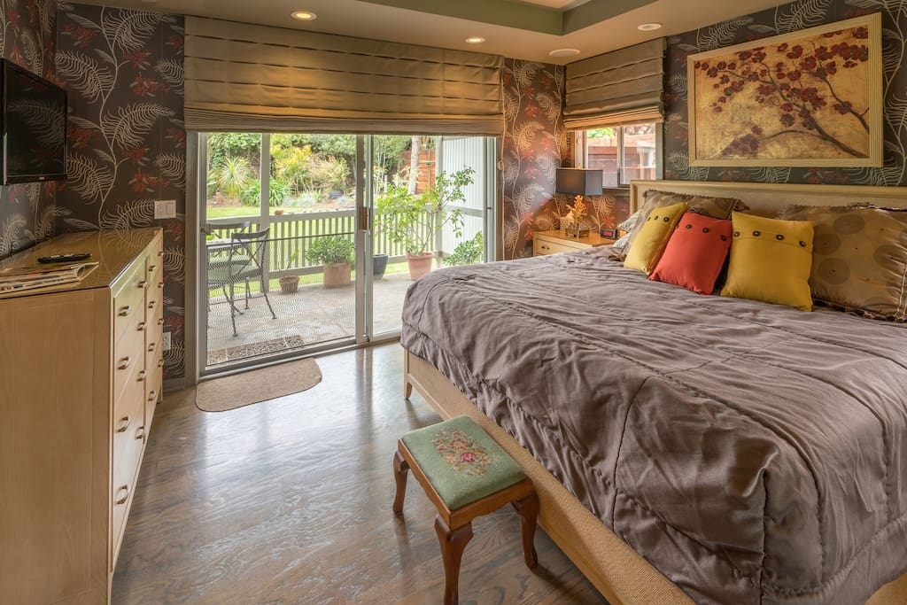 Luxurious king bed and beautifully appointed master bedroom with its own private, covered patio.