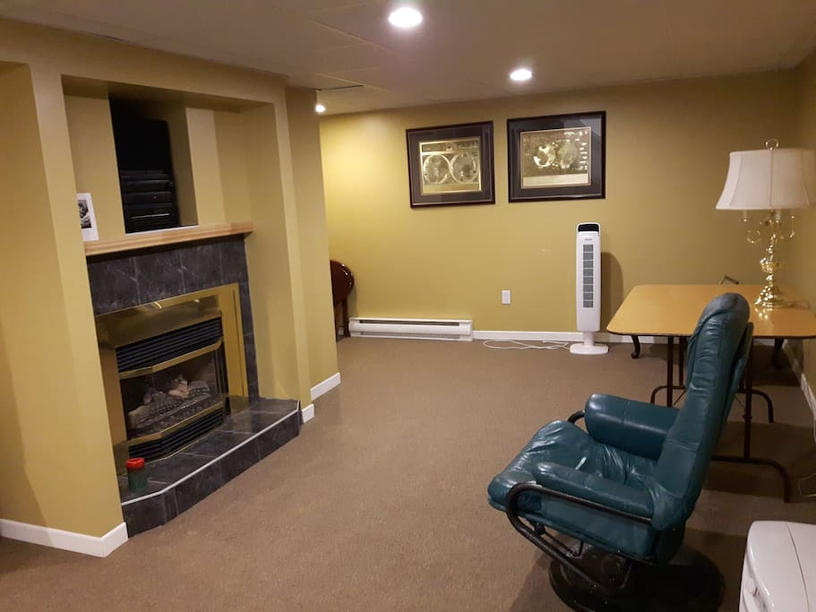 This is the living room downstairs which can be used by other clients.  There is a nice fireplace.