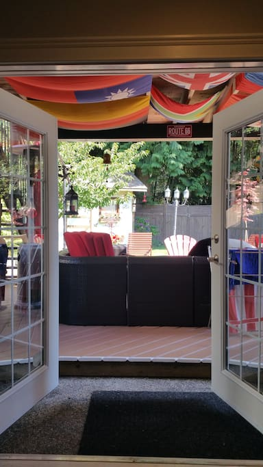 Walk out to a sunny patio overlooking the garden
