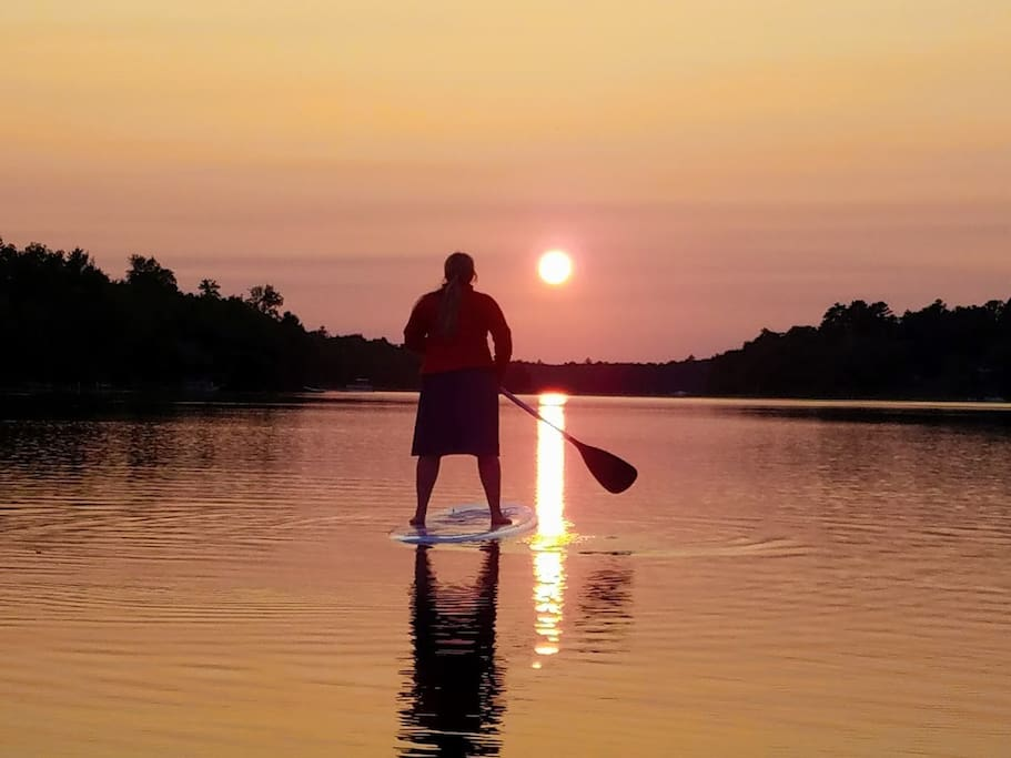 Paddling into the sunset at the Lodge on Sebec Lake