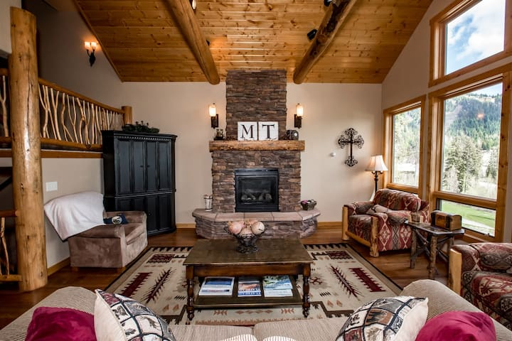 Cathedral ceilings, large windows, and a beautiful gas fireplace in the living room