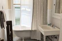 Clawfoot tub and shower. Hairdryer included