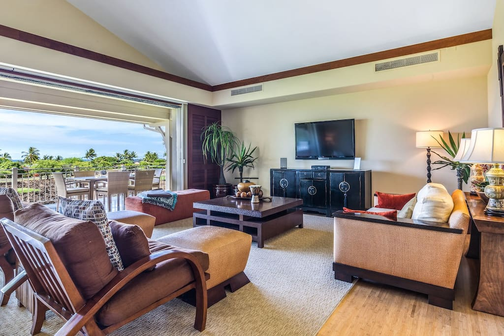 Spacious and expertly designed living area with pocket doors that open to the lanai.