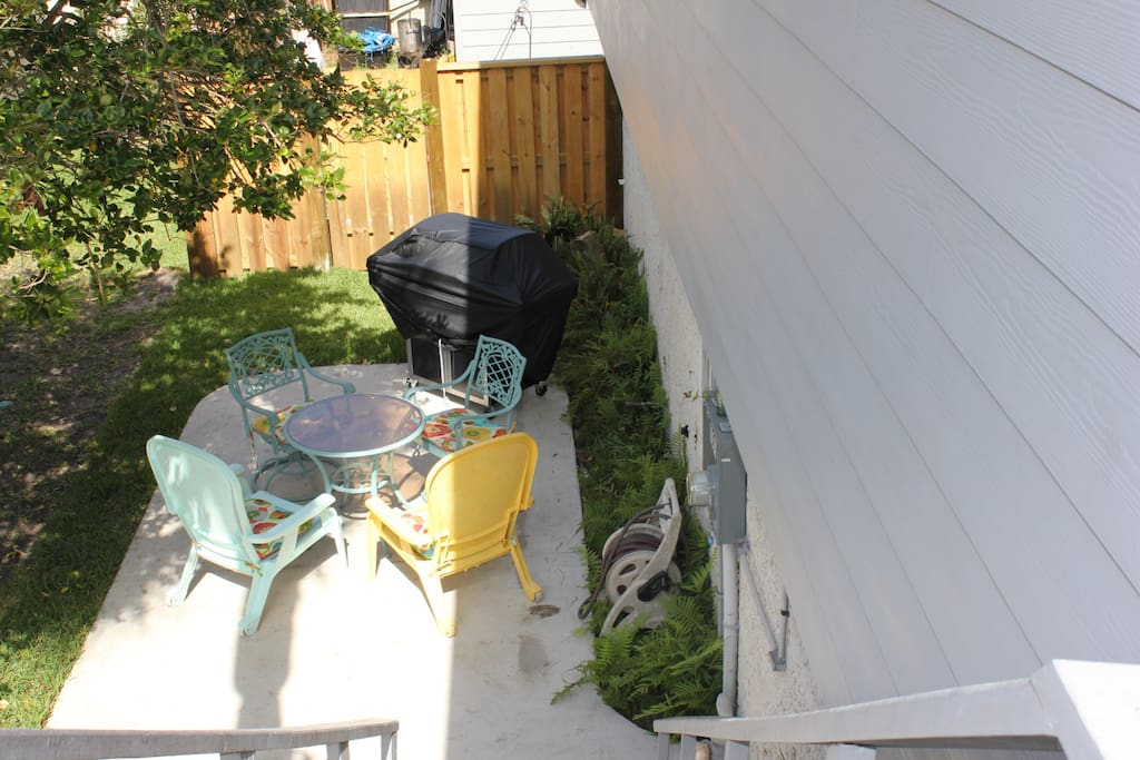 Private outdoor patio downstairs with gas grill.