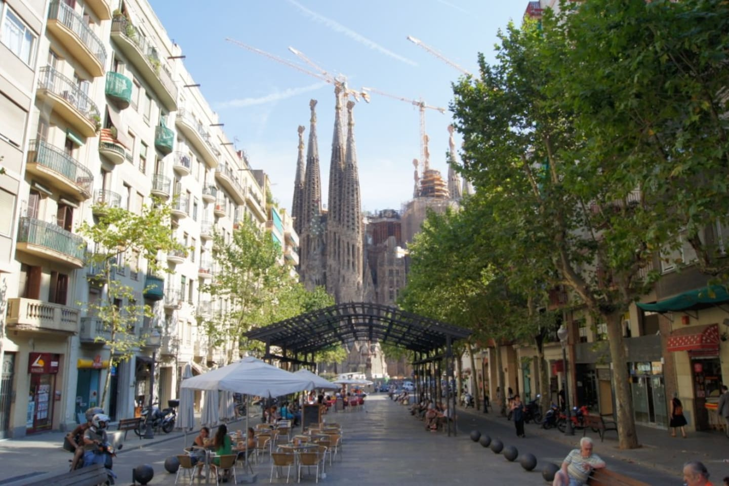 Avinguda Gaudi, pedestrian street with shops and restaurants.