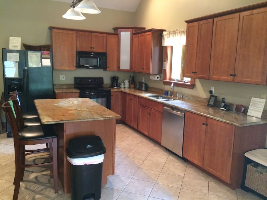 Open Kitchen with Granite Counter Top and Island.