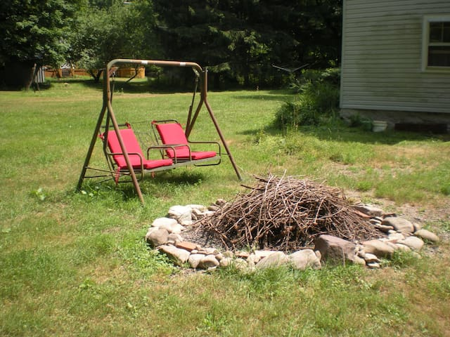Back yard with swing and fire pit