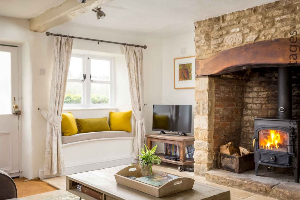 The large inglenook fireplace contains a lovely wood burning stove