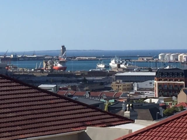 Outlook from the two front bedrooms is over industrial Woodstock, towards the Cape Town harbour.