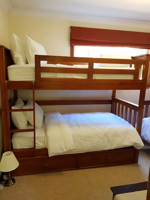2 bunk beds with trundle bed. Sealy mattresses, fresh linens ( including sheets, quilt and towels) plus side tables with touch lamps.