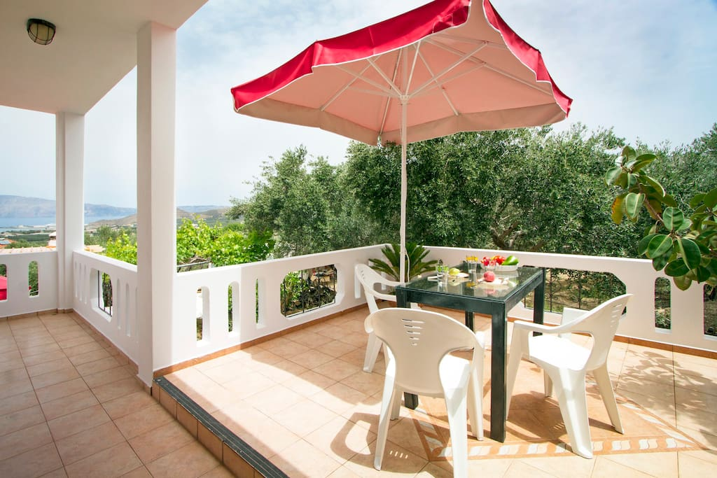 The furnished balcony on the ground floor is ideal for enjoying your morning coffee or dining outside.