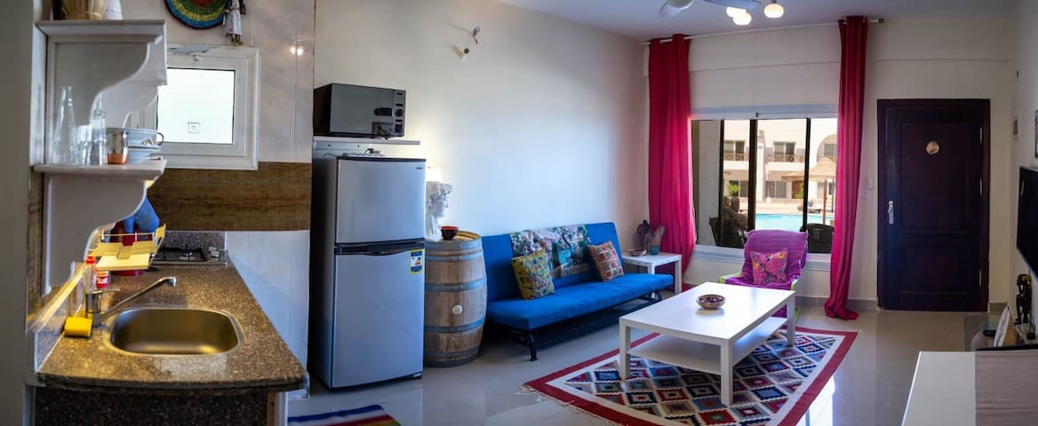 Full kitchenette with microwave and full equipment.