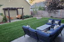 Comfortable back yard to relax and enjoy.  Please be aware this is a shared space and our Jack Russel can access this.  Please let us know if you'd like us to lock him inside.  We know dogs aren't for everyone.