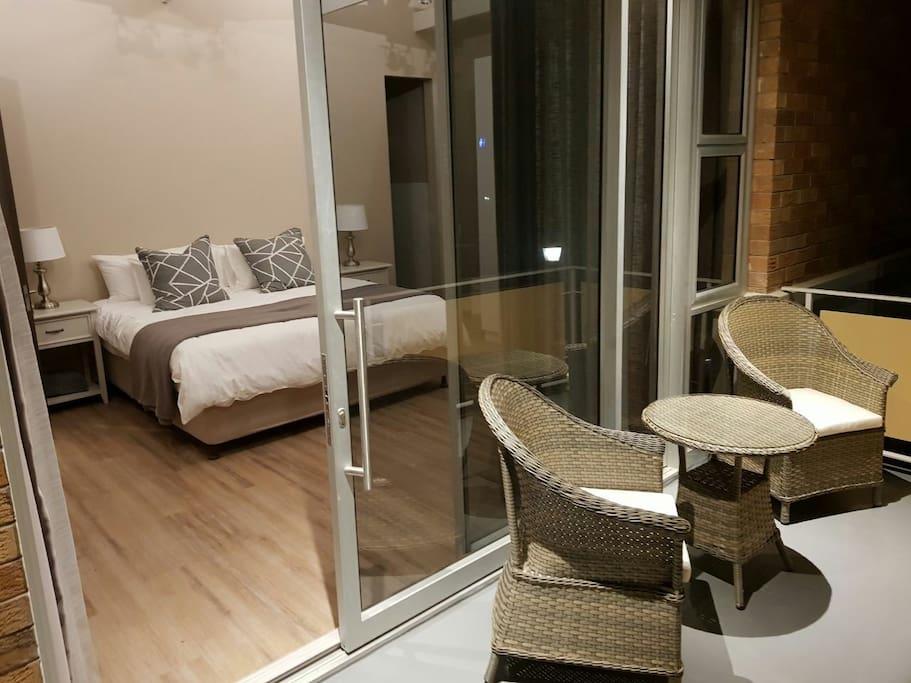 bedroom 1. beautiful neutral tones with an en-suite bathroom and balcony overlooking the gardens