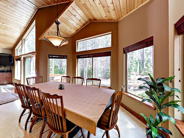 This fantastic mountain home features grand vaulted ceilings and wall-to-wall windows.