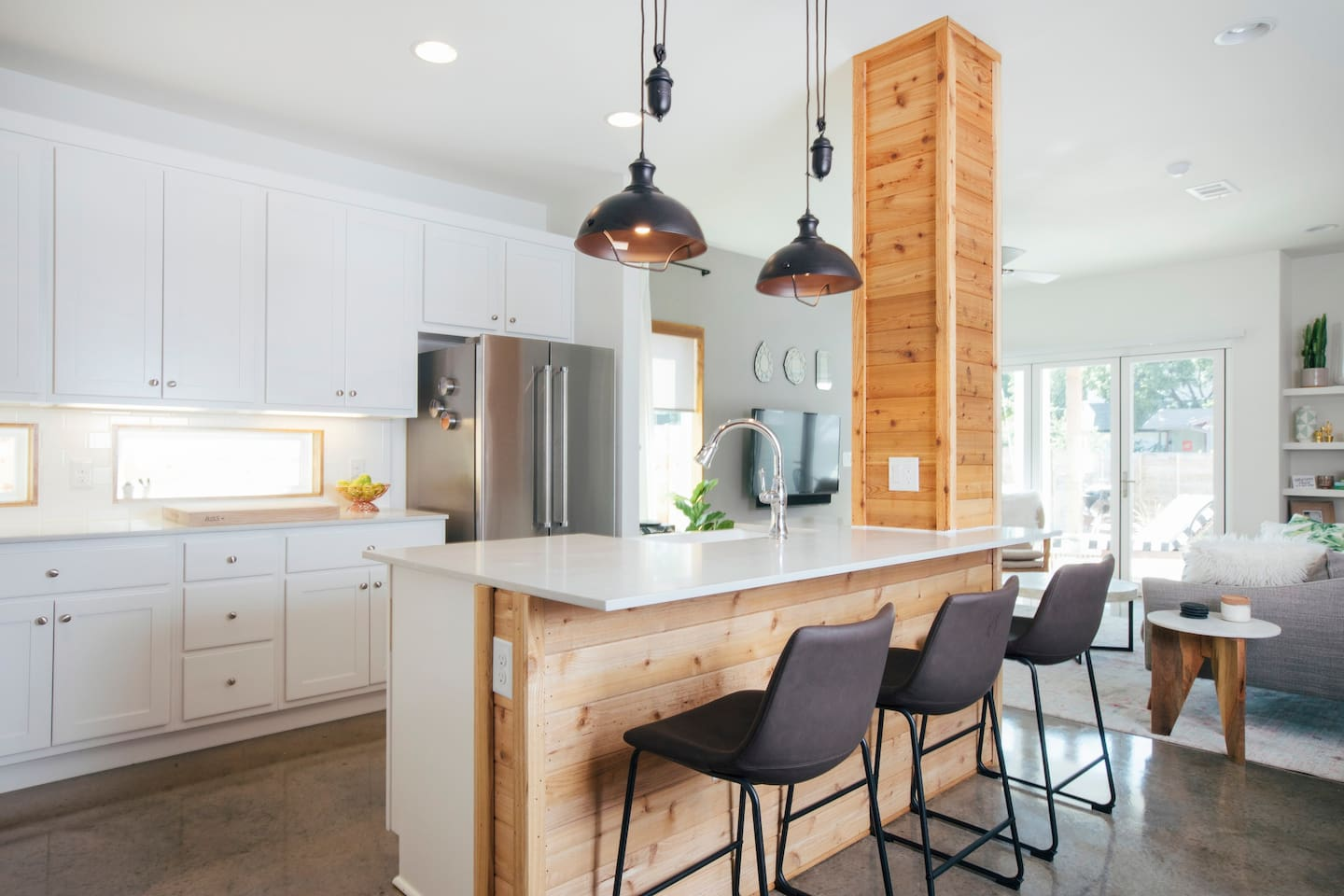 Kitchen with stainless steel appliances, island with seating