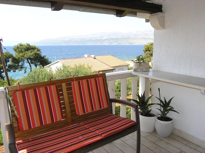 Three bedroom apartment with terrace and sea view Postira, Brač (A-11428-a)