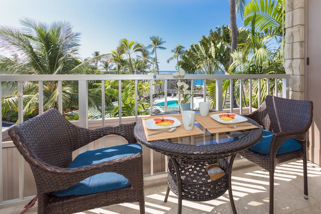 Breakfast for two with a view.  There are four chairs for the lanai too.